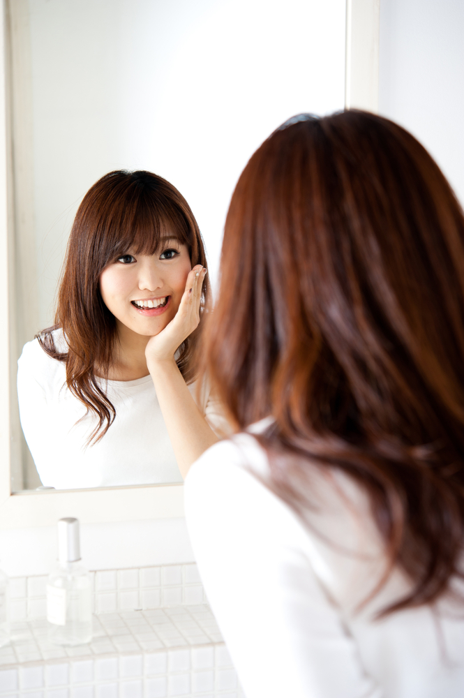 Woman talking to mirror