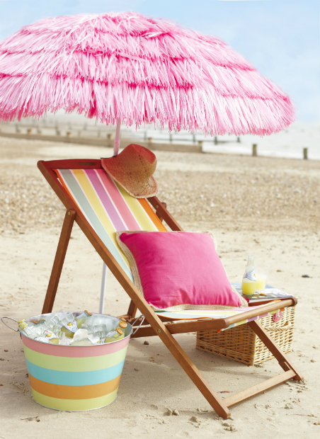 Hula Parasol, £20. Bright Stipe Wooden Deck Chair, £30. Tesco Bright Stripe Drinks Bucket, £15. Wooven Edge Cushion Pink, £10, Tesco Direct