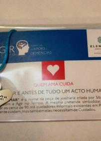 Peça de Joalheria Solidária Cuidar é Amar
