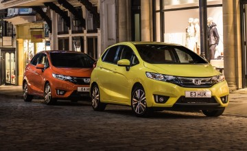 Honda Jazz on bright side of the road