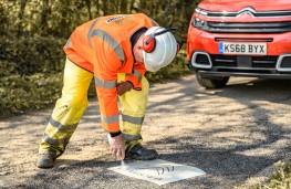 Citroen brand ambassador Austin Healey filling potholes