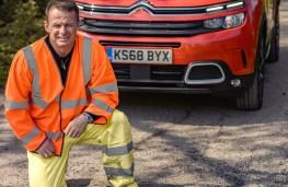 Austin Healey, Citroen brand ambassador, filling potholes