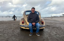 Barry Openshaw with the new gold Beetle on Southport beach