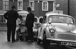 Police officers administer Breathalyser test to driver on Finden Road in London, 1967.