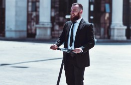Businessman on e-scooter
