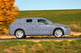 Camouflaged Skoda Scala side action