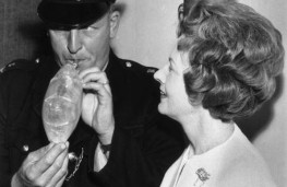 Transport Minister Barbara Castle watches Pc Frederick Griffiths of R division Traffic Unit blow into breath test kit in 1967