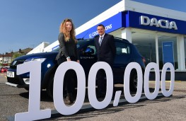 Dacia Sandero, 100000 UK sales, Heather Reiss with car at S J Cook and Sons, Bristol