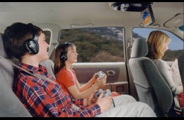 Children enjoying in-car entertainment