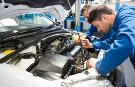 MoT test, mechanics working on car
