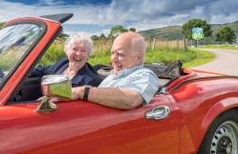 Old couple in car, retired driver
