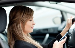 Woman driver using phone