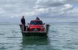 Suzuki Swift on a boat