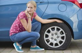 Woman driver and flat tyre