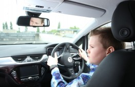 Young Driver training, boy at wheel