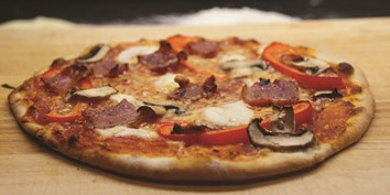 Crisp, thin dough topped with Roam & Relish organic streaky bacon and organic mozzarella cheese.