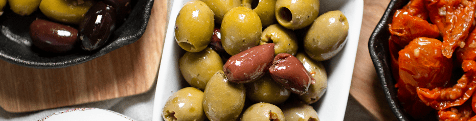 Fill your mezze board with organic stuffed olives, sundried tomatoes and more tasty organic nibbles.