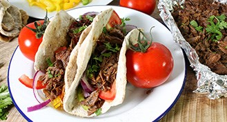 Pulled pork cheek tacos recipe with organic pork cheeks, dried spices and fresh vegetables.