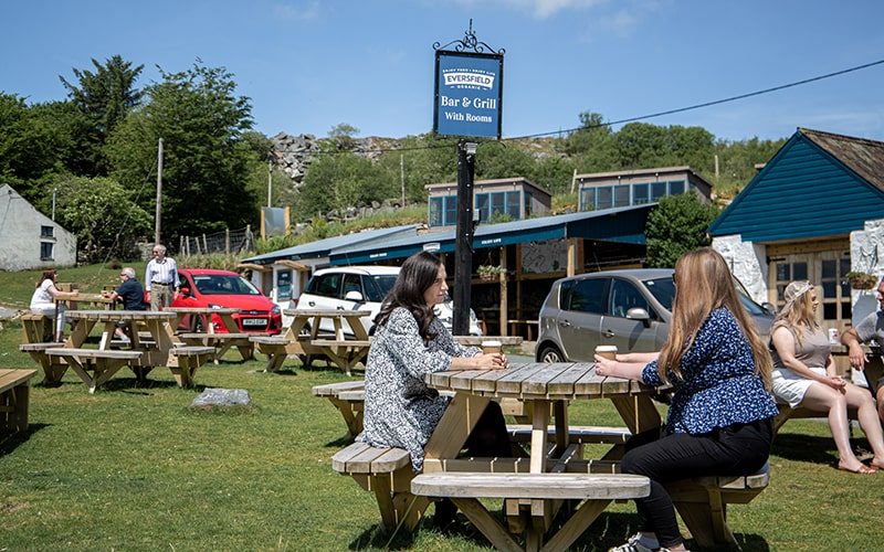 Outdoor seating for organic food and drink at the Little Farm Shed Dartmoor Inn