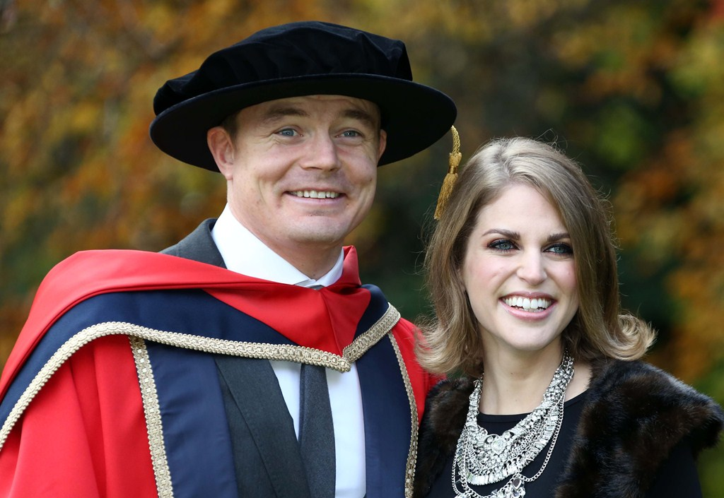 Brian O'Driscoll with his wife, Amy Huberman after he, and cyclist, Sean Kelly and Katie Taylor (who was not present) were confered with Honorary Doctorates in Philosophyat Dublin City University