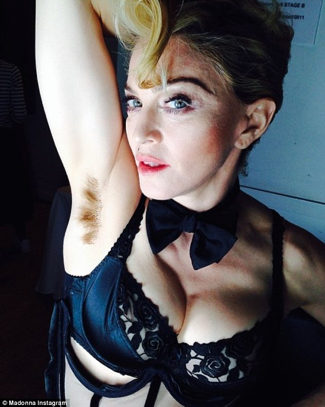 Long hair, don't care: Madonna shared this snap of herself on Instagram showing off her breasts and a hairy armpit