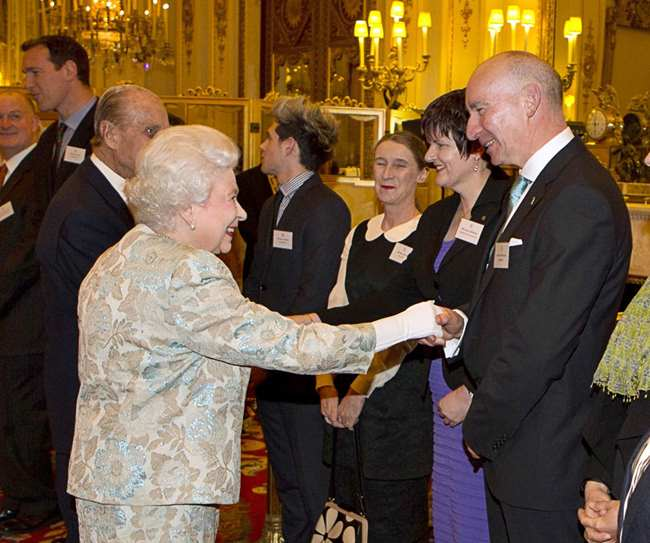 Smiling again: Queen Elizabeth and fishmonger Pat O'Connell