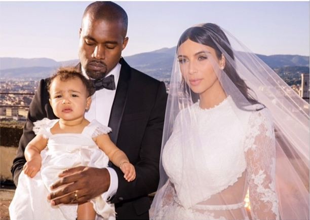 Kim on her wedding day with hubby Kanye and daughter North. Pic: Instagram