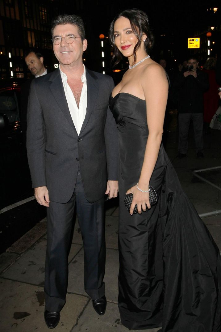 Glam couple: Simon Cowell and Lauren Silverman cut a smart figure as they arrived at the London Palladium together ahead of the Royal Variety Awards on Thursday