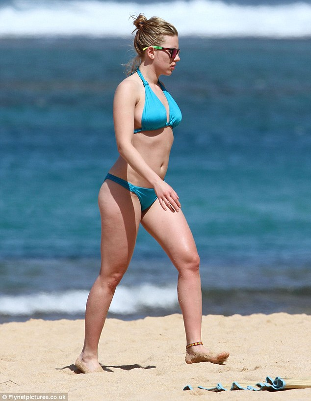 No flaws here: The 30-year-old Lucy star showing off her frame in a two piece while on a beach in 2011