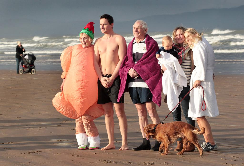The Dempsey Family taking part in the Christmas Day Swim along Portstewart Strand