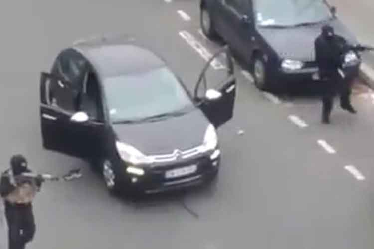 Police in gunfight with Charlie Hebdo killers in Paris last year. Pic: Rex