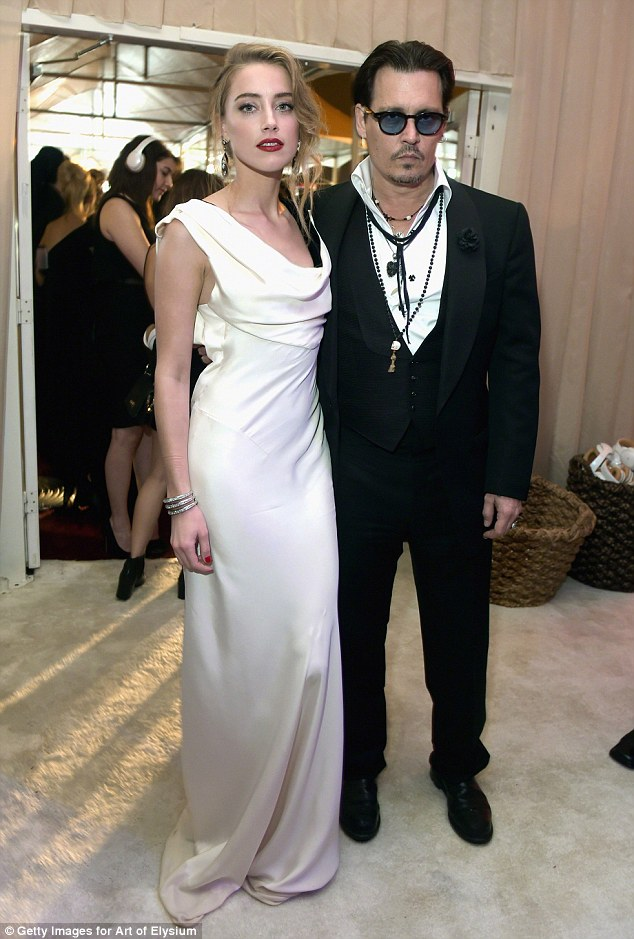 Just married! Johnny Depp, 51, and Amber Heard, 28, - pictured here together January 10 this year - have tied the knot at their home in Los Angeles, according to People