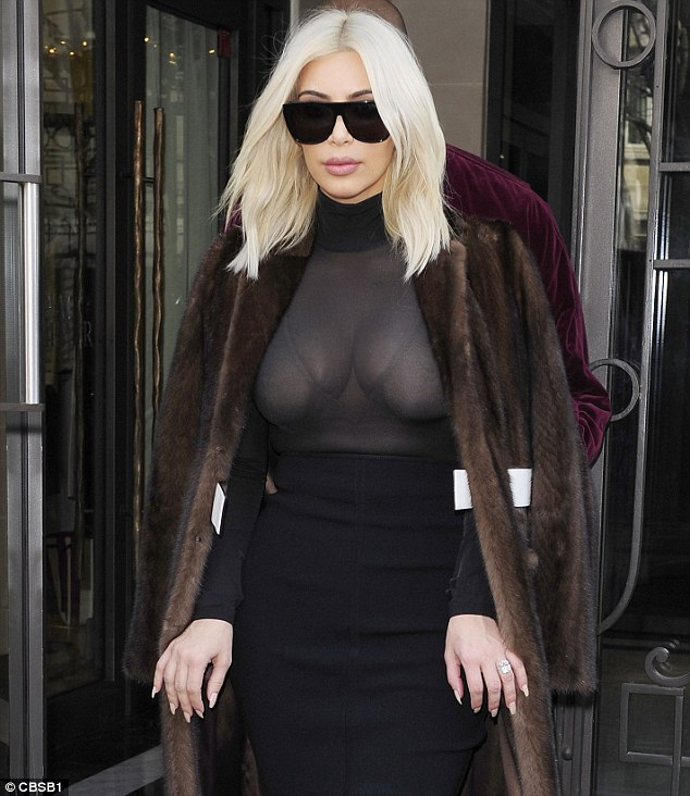 268A1F6600000578-2989758-Dramatic_look_The_platinum_blonde_hid_her_eyes_with_sunglasses_b-m-46_1426087406372