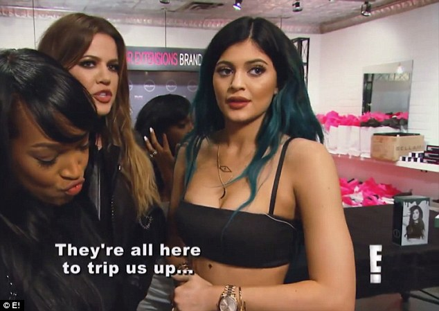 Sisterly advice: Khloe comforts Kylie after she has a run in with a reporter wanting comment on her changing appearance