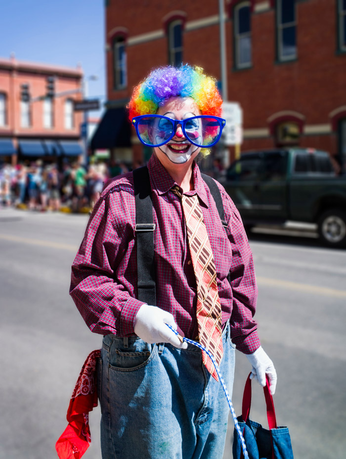 E35MRW Clown in annual FIBark Parade in small mountain town of Salida, Colorado, USA