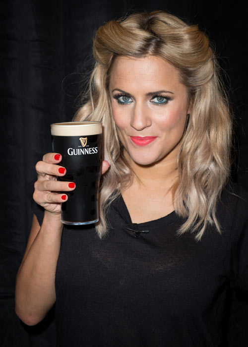 Just how many calories is Caroline Flack consuming here? Pic: File