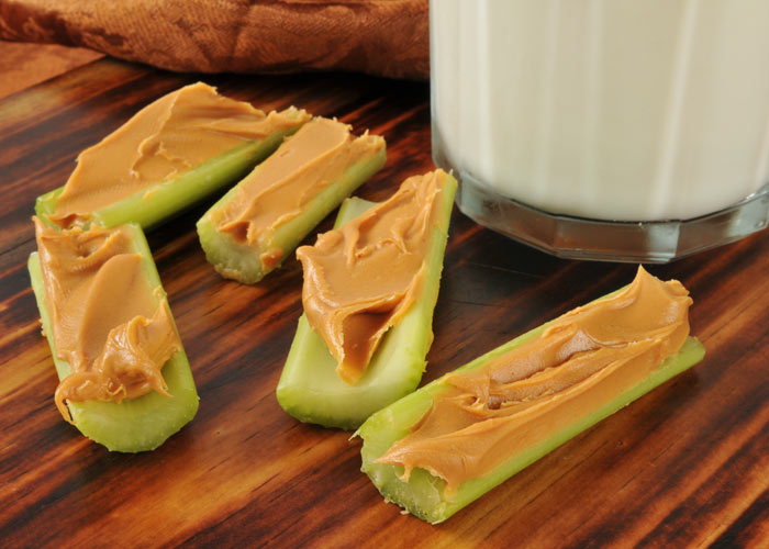 Peanut butter is the perfect snack for a flat stomach Pic: Rex
