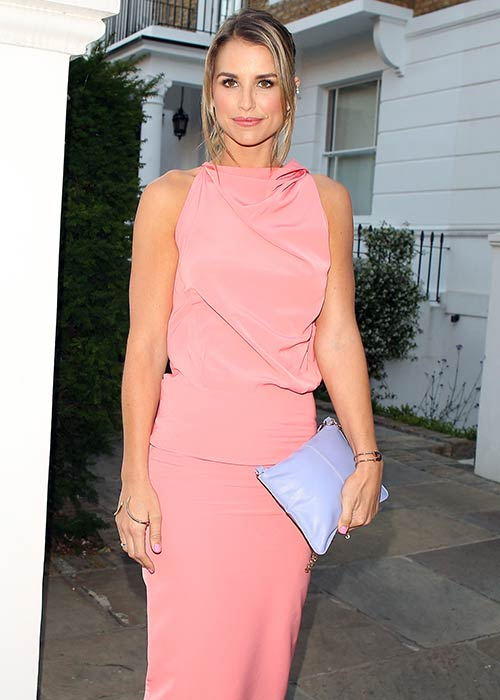Vogue wowed in a flattering pink frock