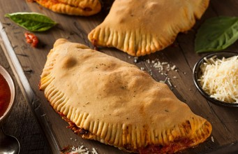 Melted Cheese and Chicken Calzones