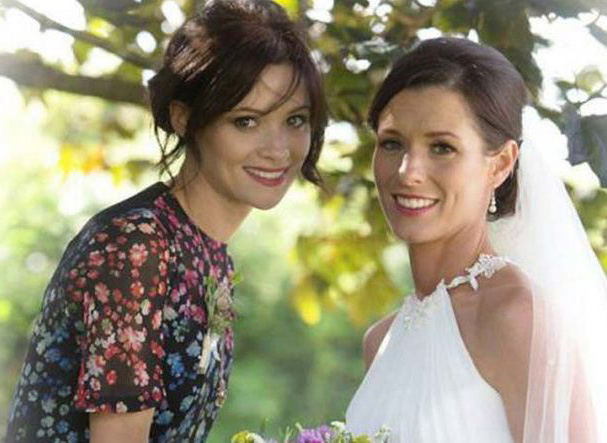 Cathriona (left) with her sister Lisa on her wedding day.