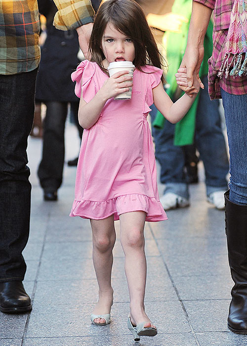 Suri Cruise was regularly snapped in heels Pic: Rex