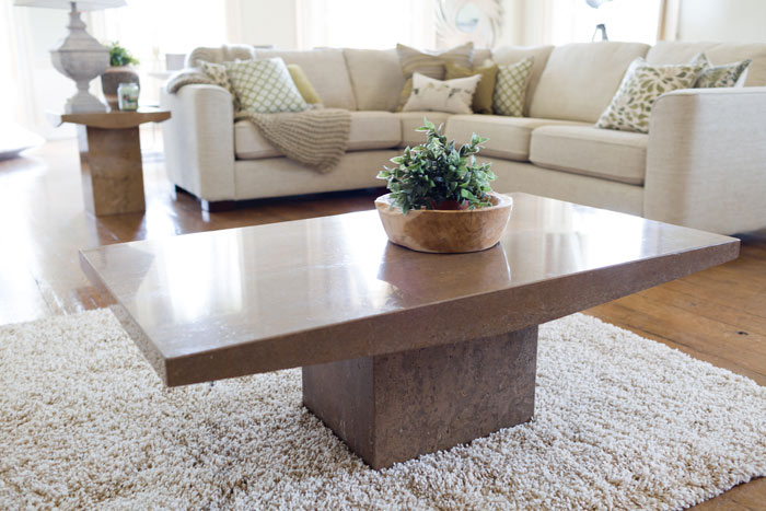 This elegant Bretoni coffee table €899 is a stunning example of marble craftsmanship, cut from solid Italian travertine. Best teamed with a contrasting material like a wool or tweed rug.