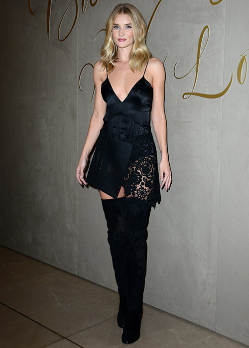 Rosie-Huntington-Whitely went for full on sexy in a slick and lace cami dress and knee-high boots