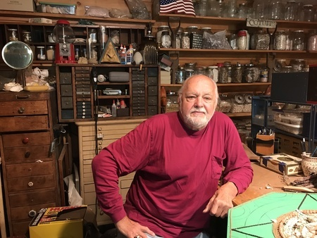 Artist Gregg Roberts invites visitors into his studio as he demonstrates the art of sailors valentines creation.