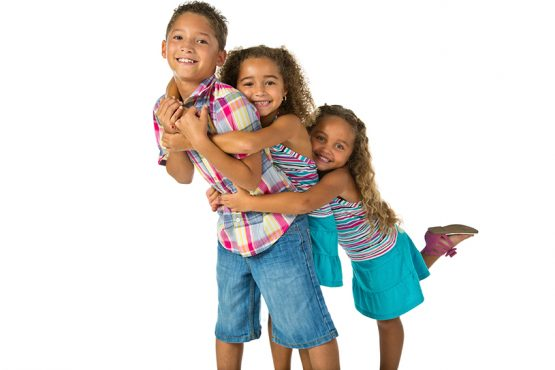 3 siblings hugging