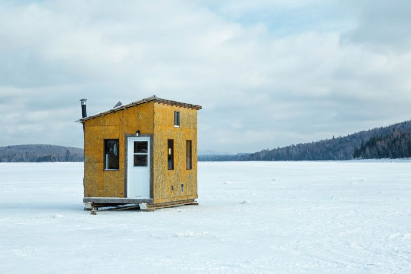 A plywood shack for ice fishing on a frozen lake