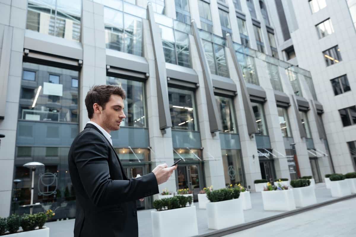 man uses phone in quiet corporate business centre