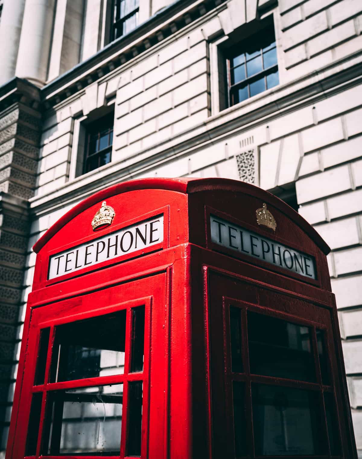 british red telephone box in front of building