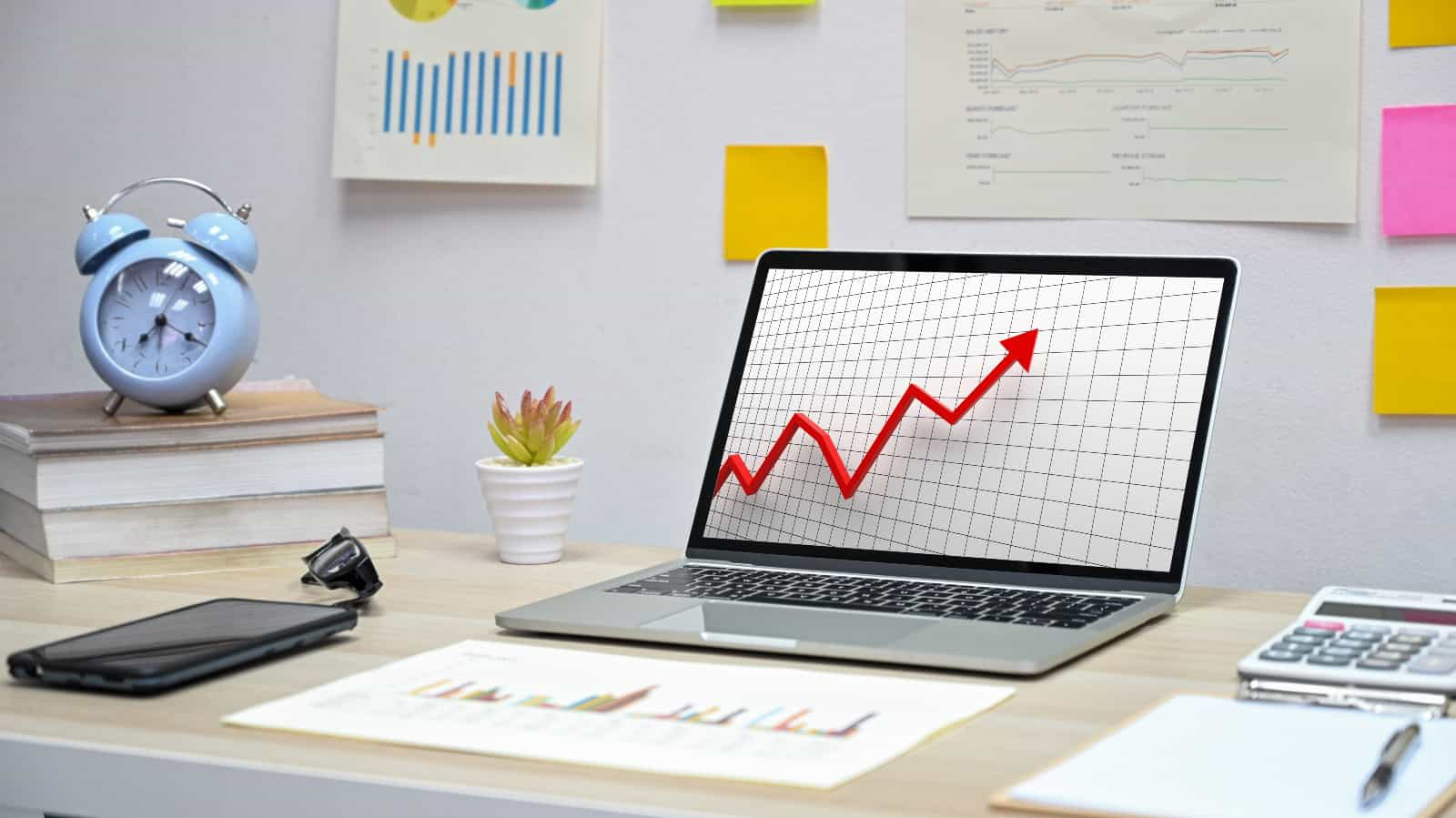 laptop with profit growth chart in office