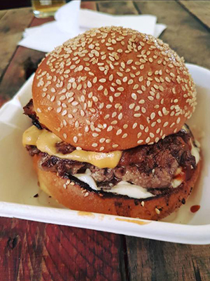 Extremely drool-worthy Dexter beef and crisp pork belly burger courtesy of The Flying Cows.